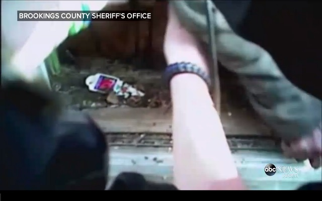 Body Camera Reveals Police Saving Woman and Her Cat from House Fire