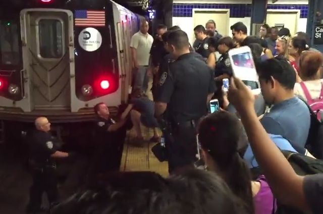 A Cat is Rescued off the Subway Tracks by NYPD